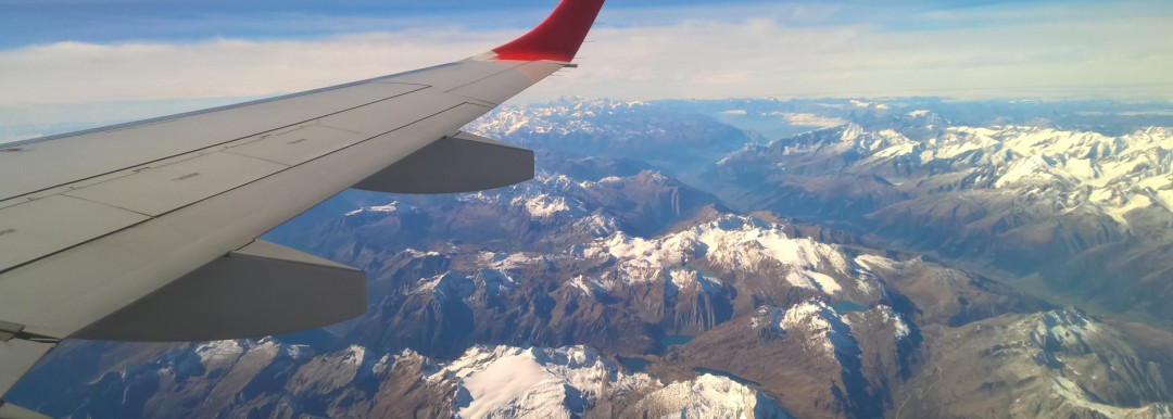 aircraft wing above mountains